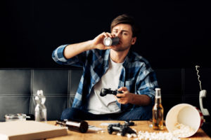crello-243432464-stock-photo-handsome-man-drinking-beer-playing